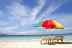 Chairs and umbrella on sand beach Royalty Free Stock Image