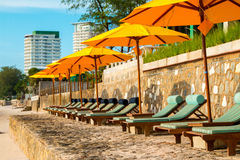 Chairs and umbrella on stunning tropical beach. In Hua Hin Thailand Royalty Free Stock Images