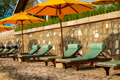 Chairs and umbrella on stunning tropical beach. In Hua Hin Thailand Stock Photography