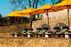 Chairs and umbrella on stunning tropical beach. In Hua Hin Thailand Stock Photos