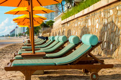 Chairs and umbrella on stunning tropical beach. In Hua Hin Thailand Stock Images