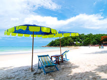Chairs and umbrella tropical beach. Two chairs and umbrella tropical beach in Samed Island, Thailand Royalty Free Stock Images