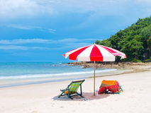 Chairs and umbrella tropical beach. Two chairs and umbrella tropical beach in Samed Island, Thailand Stock Image