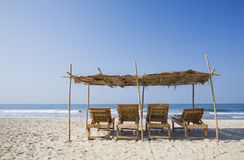 Chairs and umbrella at a tropical beach Stock Image
