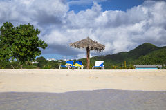 Chairs and umbrella at a tropical beach Stock Photo