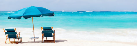 Chairs and umbrella on tropical beach. Chairs and umbrella on a beautiful tropical beach at Anguilla, Caribbean Royalty Free Stock Images