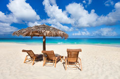 Chairs and umbrella on tropical beach Stock Photography