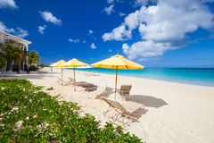 Chairs and umbrella on tropical beach Stock Photos