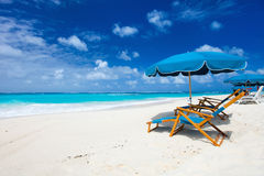 Chairs and umbrella on tropical beach Royalty Free Stock Image