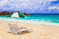 Chairs and umbrella at tropical beach. Vacations background Stock Image