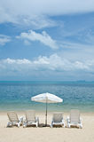Chairs and umbrellas on beach Stock Image