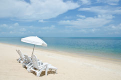 Chairs and umbrellas on beach Royalty Free Stock Image
