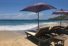 Chairs and umbrellas at the beach Stock Photos