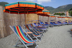 Chairs and umbrellas in the beach Stock Image