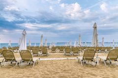 Chairs and umbrellas on a beautiful beach at Sunny Beach on the Black Sea coast of Bulgaria. Lounge blue bulgarian clouds coastline day horizontal leisure royalty free stock images
