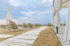 Chairs and umbrellas on a beautiful beach at Sunny Beach on the Black Sea coast of Bulgaria. Lounge blue bulgarian clouds coastline day horizontal morning no stock images