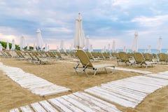 Chairs and umbrellas on a beautiful beach at Sunny Beach on the Black Sea coast of Bulgaria. Lounge blue bulgarian coastline day horizontal morning no people stock photos