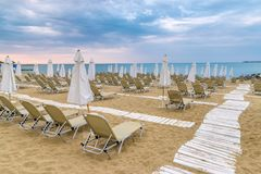 Chairs and umbrellas on a beautiful beach at Sunny Beach on the Black Sea coast of Bulgaria. Lounge blue bulgarian clouds coastline day horizontal leisure royalty free stock photo
