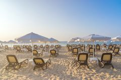 Chairs and umbrellas on a beautiful beach at sunrise in Sunny Beach on the Black Sea coast of Bulgaria. Lounge bulgarian coastline copy space copyspace day royalty free stock image