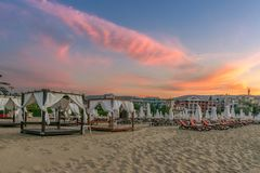 Chairs and umbrellas on a beautiful beach at sunrise in Sunny Beach on the Black Sea coast of Bulgaria. Bulgarian clouds coastline dawn day horizontal morning royalty free stock photography