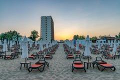 Chairs and umbrellas on a beautiful beach at sunrise in Sunny Beach on the Black Sea coast of Bulgaria. Lounge bulgarian coastline dawn day horizontal no people stock photo
