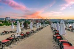 Chairs and umbrellas on a beautiful beach at sunrise in Sunny Beach on the Black Sea coast of Bulgaria. Lounge bulgarian clouds coastline dawn day horizontal stock photo