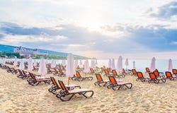 Chairs and umbrellas on a beautiful beach at sunrise in Sunny Beach on the Black Sea coast of Bulgaria. Lounge bulgarian clouds coastline day horizontal leisure stock photos