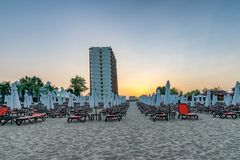 Chairs and umbrellas on a beautiful beach at sunset in Sunny Beach on the Black Sea coast of Bulgaria. Bulgarian coastline dawn day horizontal no people nobody stock photo
