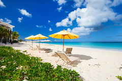 Chairs and umbrellas on tropical beach. Chairs and umbrellas on a beautiful tropical beach at Anguilla, Caribbean Stock Photo
