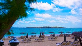 The chairs and umbrellas on tropical beach Royalty Free Stock Photography