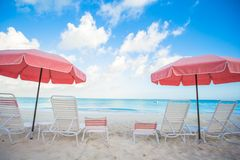 Chairs and umbrellas on stunning tropical beach Stock Photography