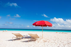 Chairs and umbrellas on a tropical beach Royalty Free Stock Images