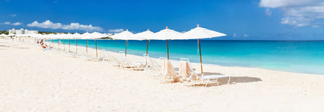 Chairs and umbrellas on tropical beach. Chairs and umbrellas on a beautiful tropical beach at Anguilla, Caribbean Royalty Free Stock Image