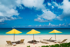 Chairs and umbrellas on tropical beach. Chairs and umbrellas on a beautiful tropical beach at Anguilla, Caribbean Stock Image