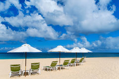 Chairs and umbrellas on tropical beach. Chairs and umbrellas on a beautiful tropical beach at Anguilla, Caribbean Stock Images