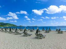 The chairs and umbrellas on tropical beach. The chairs and umbrellas on Caribbean tropical beach Royalty Free Stock Photo