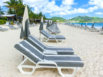 The chairs and umbrellas on tropical beach. The chairs and umbrellas on Caribbean tropical beach Stock Photography