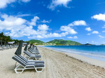 The chairs and umbrellas on tropical beach. The chairs and umbrellas on Caribbean tropical beach Royalty Free Stock Photography