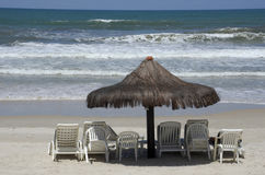 Chairs and umbrellas on tropical beach. PORTO SEGURO, BA, BRAZIL - AUGUST 14, 2016 - Chairs and umbrellas on Brazilian tropical beach Stock Image
