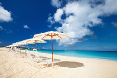 Chairs and umbrellas on tropical beach. Row of chairs and umbrellas on a beautiful tropical beach at Anguilla, Caribbean Stock Images