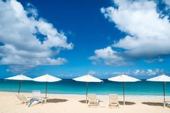 Chairs and umbrellas on tropical beach. Row of chairs and umbrellas on a beautiful tropical beach at Anguilla, Caribbean Stock Image