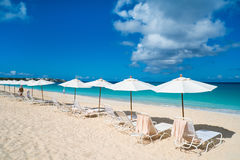 Chairs and umbrellas on tropical beach. Row of chairs and umbrellas on a beautiful tropical beach at Anguilla, Caribbean Royalty Free Stock Image