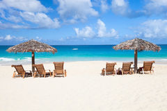 Chairs and umbrellas on tropical beach. Chairs and umbrella on a beautiful tropical beach at Anguilla, Caribbean Stock Images