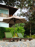 Chairs under the umbrella. Two green chairs in the garden resort Stock Photography