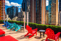 Chairs and view of Midtown Manhattan at the rooftop of Pod 51, N Stock Images