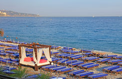 Chairs with VIP place, Nice city. Lot of deck chairs with VIP place on the beach of Nice city, France Stock Photos