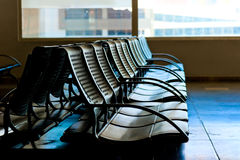 Chairs for waiting plane at the airport Stock Images