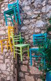 Chairs on the wall. Photographed in small street in city Biograd na moru, Croatia Royalty Free Stock Photos