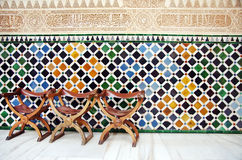 Chairs and the wall of tiles in The Alhambra Royalty Free Stock Photography