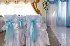Chairs for the wedding ceremony. Are decorated with blue bows Royalty Free Stock Photography